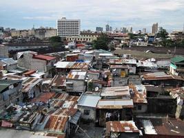 Hausbesetzer und Häuser in einem Slum-Stadtgebiet