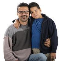 fröhliches Kind und Vater foto