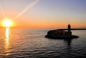 Sonnenuntergang und Leuchtturm foto