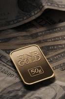 Gold auf Dollar foto