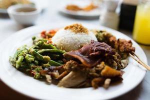 Spanferkel gemischter Reis foto