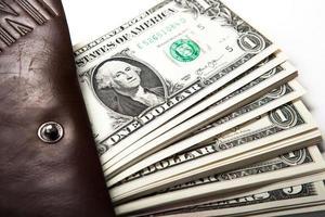 Geld in Ihrer Brieftasche ausgeben foto