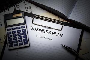 Geschäftsstillleben mit Geschäftsplan foto