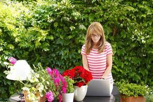 kleiner Blumenladenbesitzer foto