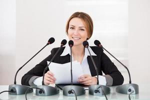 Geschäftsfrau in der Konferenz foto