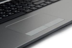Nahaufnahme Touchpad und Tastatur des Laptops foto