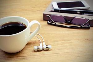 Notizbuch mit Kaffee foto