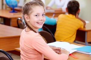 entzückendes Schulkind foto