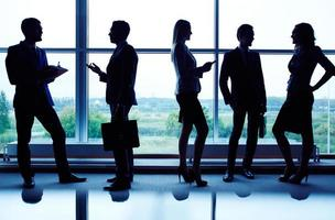 Silhouetten des Geschäftsteams foto