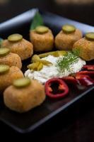 Kartoffelkroketten mit Gemüse foto