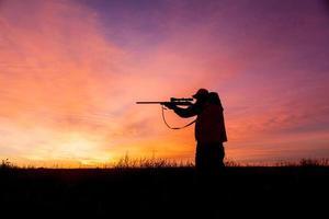 Jäger bei Sonnenaufgang foto