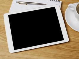 digitales Tablet auf dem Schreibtisch foto