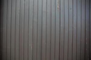 dunkelgrauer hölzerner Hintergrund und Schmutz foto