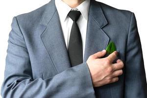 Der Geschäftsmann trägt einen Anzug foto