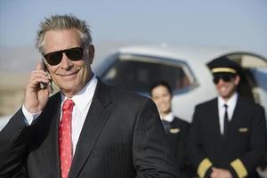 Geschäftsmann am Flughafen foto