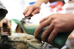 Schuhe entwerfen, Beruf Schuhmacher foto