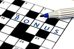 Bonus beim Lösen von Kreuzworträtseln, Nahaufnahme foto