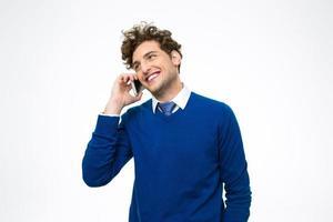 Geschäftsmann, der am Telefon spricht foto