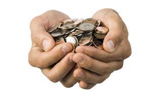 Hände voller Münzen foto