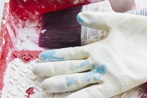 Hausaufgaben Pinsel weiße Farbe Handschuhe hellblau foto