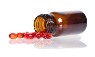 rote Pillen eine Tablettenfläschchen
