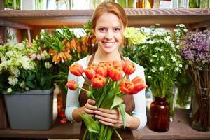 Verkäufer von frischen Blumen foto