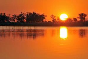 untergehende Sonne, Botswana foto