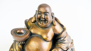 lustiges Lachen und fröhliches goldenes Kupferbuddha oder hotei foto