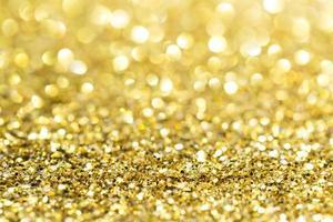 Gold abstrakter Glitzerhintergrund mit Kopierraum