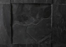 schwarzer Granit Textil Textur Hintergrund mit Kopierraum schließen foto