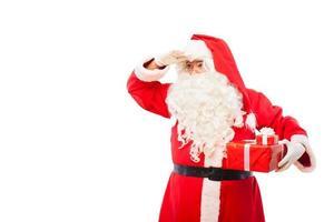 Weihnachtsmann mit Geschenken lokalisiert auf Weiß, mit Kopienraum