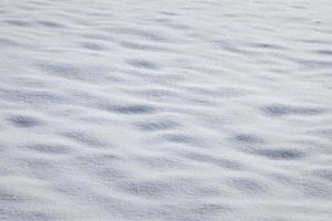 sonniger Neuschnee Nahaufnahme Textur kopieren Raum Hintergrund foto