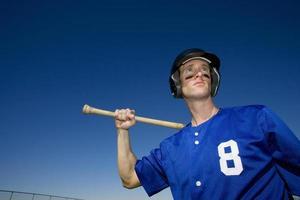 Baseballspieler, in der blauen Uniform Nummer 8 foto