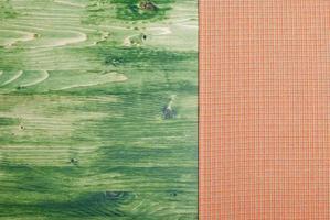 Serviette auf einer grünen Tafel rechts, links foto