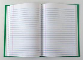 grünes Notizbuch foto