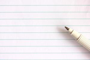 Stift auf Notizbuch foto