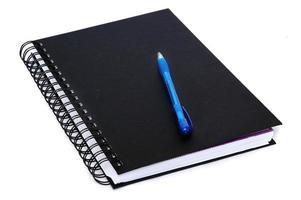 Buch mit Bleistift schreiben foto