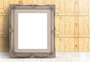 leerer hellbrauner Vintage-Rahmen auf Marmorboden, Holzwand