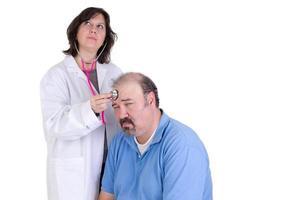 Tag träumende Praktikantin und ihre ruhige Patientin foto