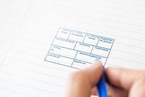 Papier mit Zahlstempel zur Unterschrift foto