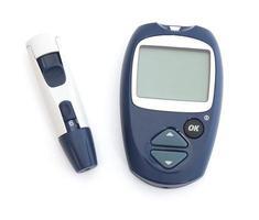 Glukometer und ein Schlag foto
