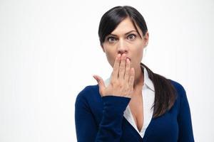 verblüffte Geschäftsfrau, die Kamera betrachtet foto
