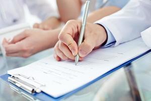 medizinisches Formular ausfüllen foto