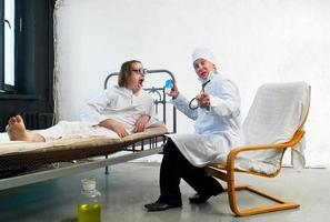 Arzt und Patient foto