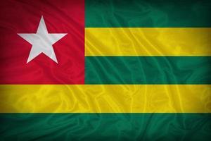 Togo Flag Muster auf der Stoff Textur, Vintage-Stil foto