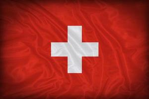 Schweiz Flaggenmuster auf der Stoffstruktur, Vintage-Stil foto
