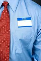 Geschäftsmann mit leerem Namensschild foto
