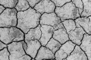 Boden rissiges trockenes Muster für Hintergrund. foto
