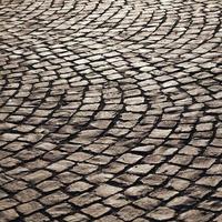 Muster der alten Kopfsteinpflasterstraße foto