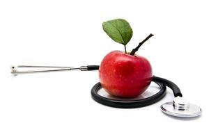 Apfel und Stetoskop foto